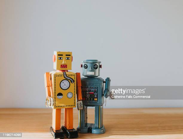 robots on a shelf - toy stock pictures, royalty-free photos & images