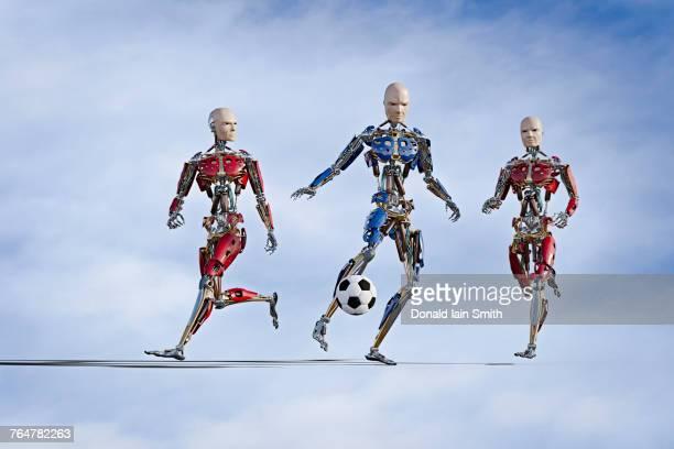 robots playing soccer - sportlicher zweikampf stock-fotos und bilder