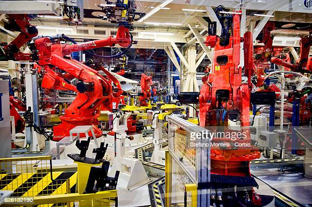 Robots stand in the Body Shop where they assemble the Alfa Romeo Giulia in the Cassino Assembly Plant FCA Group This is the most highlyautomated area...