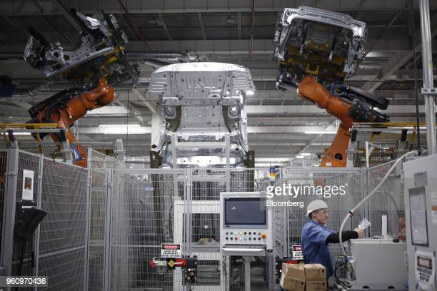 Robots weld car body components for vehicles at the Bayerische Motoren Werke AG Manufacturing Co assembly plant in Greer South Carolina US on...