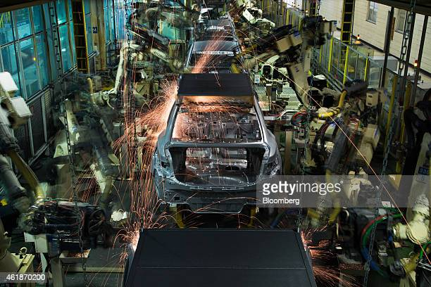 Robots weld Hyundai Motor Co vehicle frames on the production line at the company's factory in Asan South Korea on Tuesday Jan 20 2015 Hyundai South...