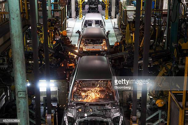 Robots weld the bodies of Honda Motor Co Mobilio vehicles on the production line at the Honda Cars India Ltd plant in Greater Noida India on Tuesday...