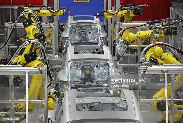 Robots weld the bodies of Porsche Macan SUVs at the new Porsche Macan factory at the Porsche plant on February 11 2014 in Leipzig Germany Porsche...