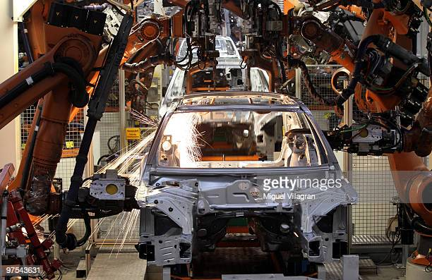 Robots weld the car body of an Audi at the production line on March 8 2010 in Ingolstadt Germany Audi AG is a unit of Volkswagen AG