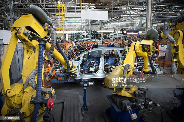 Robots welding car body in car factory