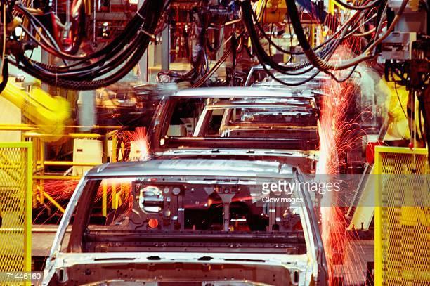 Robots welding cars in a factory, Smyrna, Georgia, USA