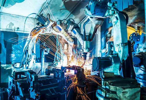 Robots welding in a car factory 1047970286