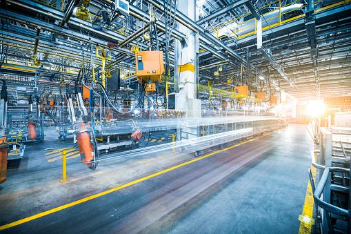 robots welding in a car factory 846859964