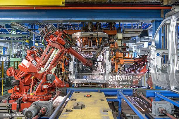 Robots welding van body in car plant