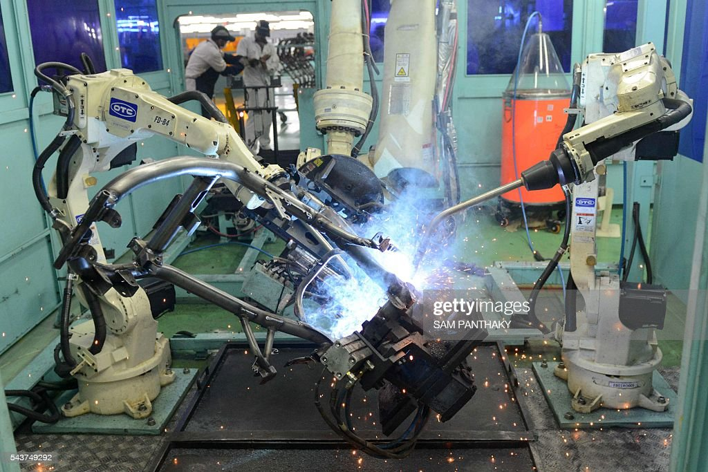 Robots welds metal parts to be used in the production of