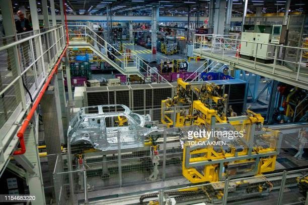 Robots work on the MINI production line at the BMW group plant in Cowley near Oxford on July 9 2019