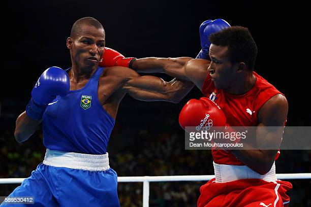 Robson Conceicao of Brazil and Lazaro Alvarez of Cuba compete in the Lightweight 60kg Men boxing bout on Day 9 of the Rio 2016 Olympic Games at...