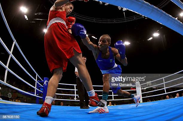 Robson Conceicao of Brazil fights Anvar Yunusov of Tajikistan in their Mens Lightweight 60kg bout on Day 4 of the Rio 2016 Olympic Games at the...