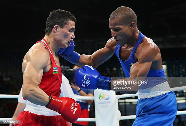 Robson Conceicao of Brazil lands a right shot on Hurshid Tojibaev of Uzbekistan during the Men's Lightweight Preliminaries bout on Day 7 of the 2016...