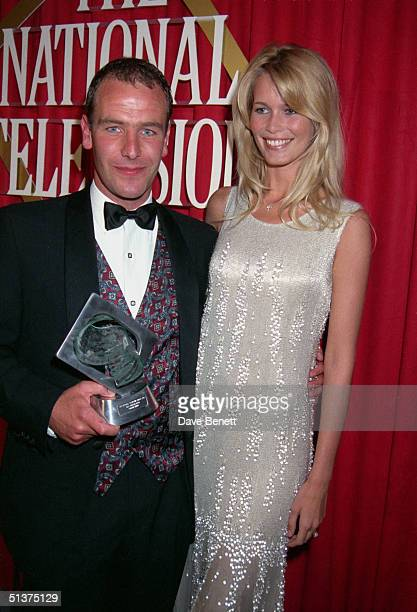 Robson Green collects his Most Popular Actor award for 'Soldier Soldier' from German supermodel Claudia Schiffer at the UK National Television Awards...