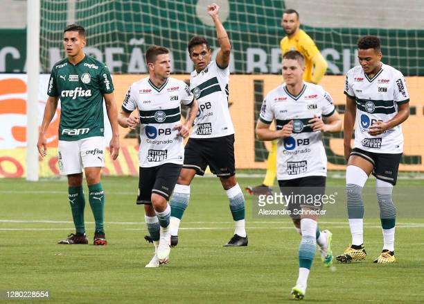 Robson of Coritiba celebrates with his team mates after scoring the first goal of their team during the match against Palmeiras as part of...