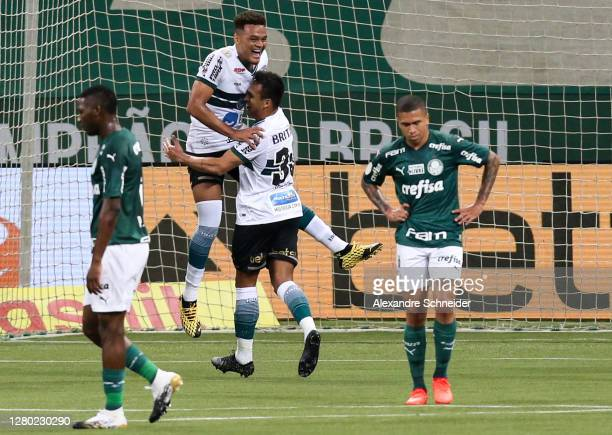 Robson of Coritiba celebrates with team mate after scoring the second goal of their team during the match against Palmeiras as part of Brasileirao...