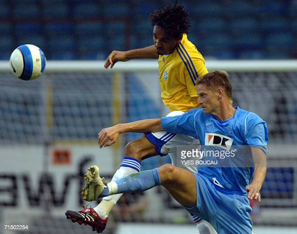 Robson Weligton of Grasshopper Club Zurich vies with Dominic Foley of KAA Gent during Intertoto Cup KAA Gent vs Grasshopper Club Zurich 22 July 2006...