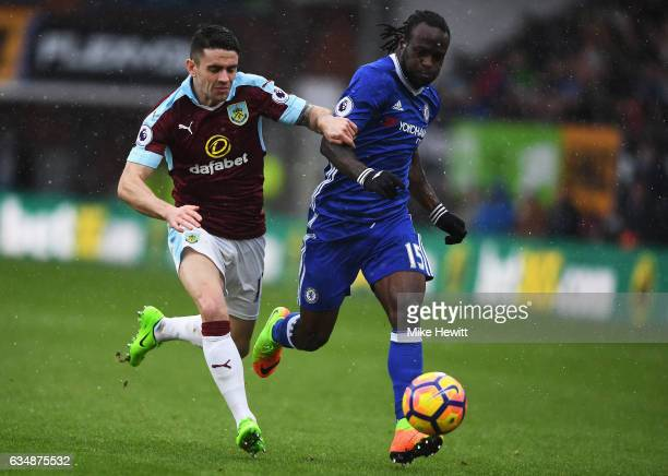 Roby Brady of Burnley and Victor Moses of Chelsea in action during the Premier League match between Burnley and Chelsea at Turf Moor on February 12...