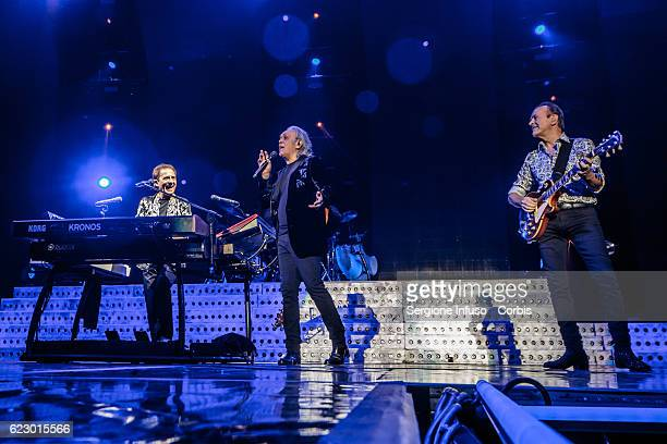 Roby Facchinetti Riccardo Fogli and Dodi Battaglia of Italian pop band Pooh perform on stage on November 11 2016 in Milan Italy