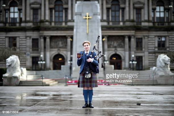 TOPSHOT Robyn Ada McKay a bagpiper studying at The Royal Conservatoire of Scotland poses with her passport on January 22 2018 in Glasgow On Brexit...