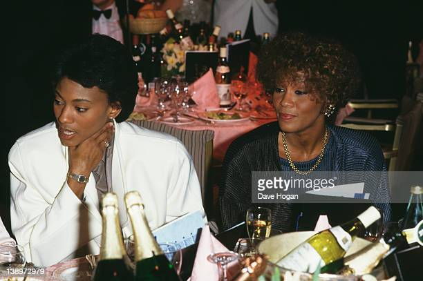 Robyn Crawford left and American singer Whitney Houston circa 1988