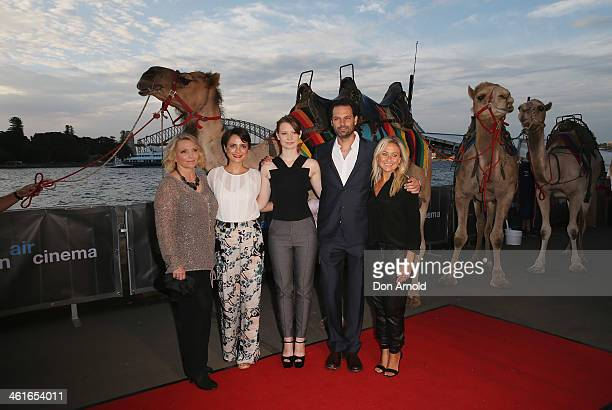 Robyn Davidson Jessica Tovey Mia Wasikowska Emile Sherman and Carolyn Sherman pose alongside camels at the St George Openair Cinema Tracks premiere...