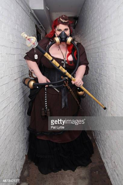 Robyn dressed in Steam Punk style wears a brown dress a respirator walking stick and hat during the Whitby Goth Weekend on April 26 2014 in Whitby...