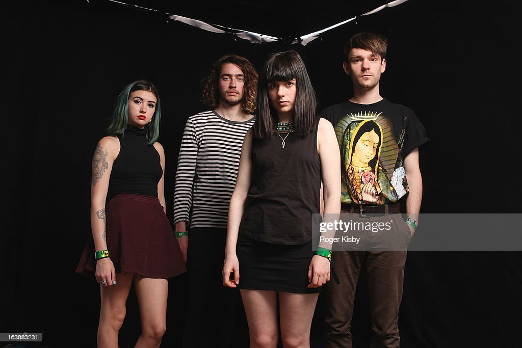 Robyn Edwards, Michael Miles, Jessica Weiss and Daniel Falvey of Fear of Men pose for a portrait backstage at The Fader Fort presented by Converse during SXSW on March 16, 2013 in Austin, Texas.