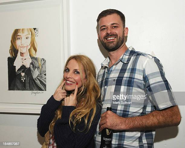 Robyn Holt and Justin Hummer during the opening reception for Diane MarshallGreen's Lolitas at America Martin Gallery on October 27 2012 in Los...