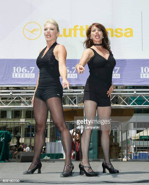 Robyn Hurder and Donna Marie Asbury from the cast of Chicago perform during 1067 Lite FM's Broadway in Bryant Park 2017 on August 3 2017 at Bryant...