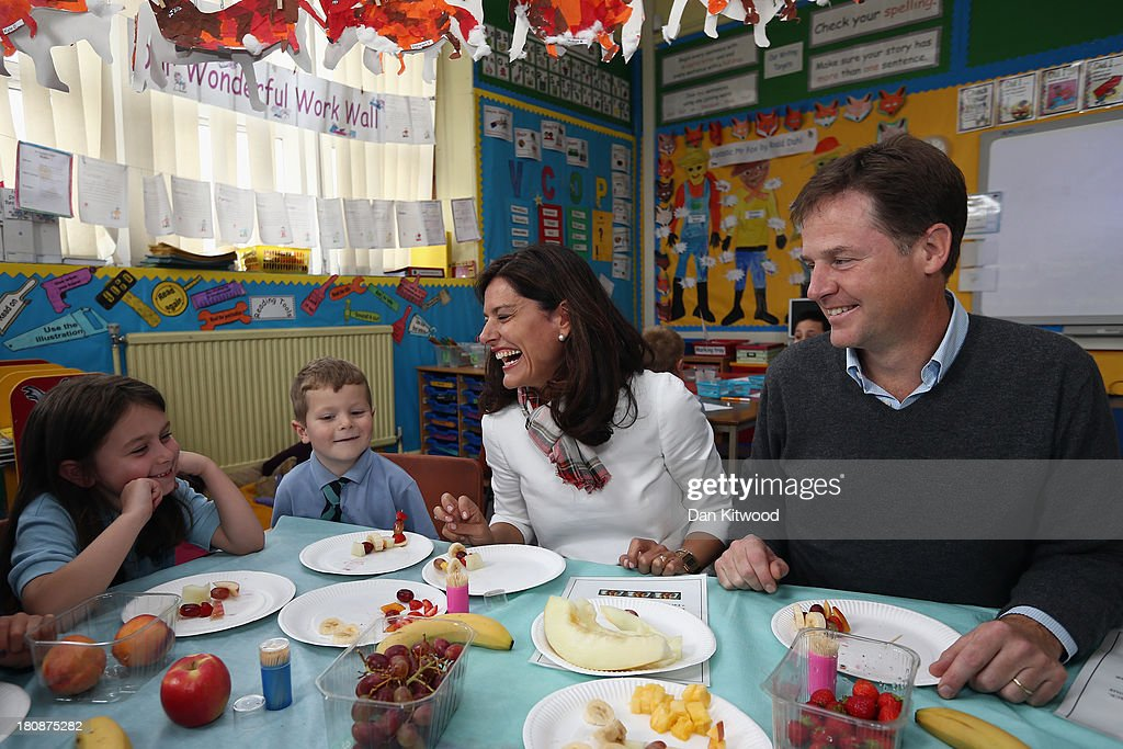 Robyn Kourmides, 6, (L) and Dylan Hogg, 6, Liberal Demcrat leader Nick Clegg and his wife Miriam Gonzalez Durantez take part in a 'Healthy Eating' class at Lairdsland Primary School on September 17, 2013 in Glasgow, Scotland. Danny Alexander, Chief Secretary to the Treasury will give his key-note speech today when he will focus on the economy. Today is day four of the Liberal Democrat Autumn conference.
