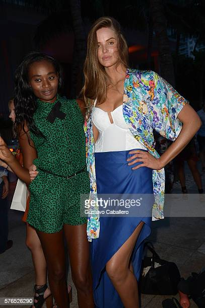 Robyn Lawley and guest attend KAOHS 2017 Collection at SwimMiami Backstage at W South Beach on July 15 2016 in Miami Beach Florida