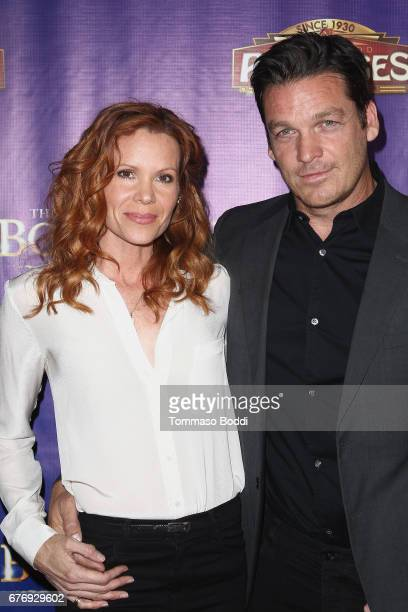 Robyn Lively and Bart Johnson attend the Premiere Of 'The Bodyguard' at the Pantages Theatre on May 2 2017 in Hollywood California