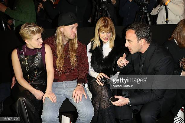 Robyn Max Vitali Tina Gregouriou and Nikos Aliagas attend the Jean Paul Gaultier Fall/Winter 2013 ReadytoWear show as part of Paris Fashion Week on...