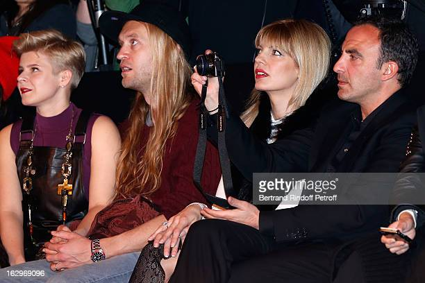 Robyn Max Vitali Tina Grigoriou and Nikos Aliagas attend the Jean Paul Gaultier Fall/Winter 2013 ReadytoWear show as part of Paris Fashion Week on...