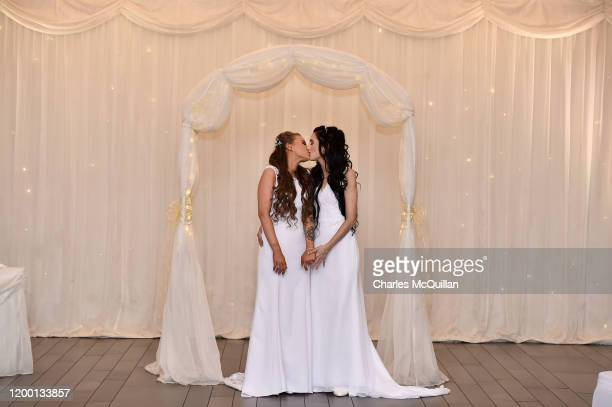 Robyn Peoples and Sharni Edwards embrace and kiss after they became Northern Ireland's first legally married same sex couple on February 11 2020 in...