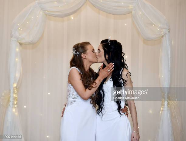 Robyn Peoples and Sharni Edwards embrace and kiss after they became Northern Irelands first legally married same sex couple on February 11 2020 in...