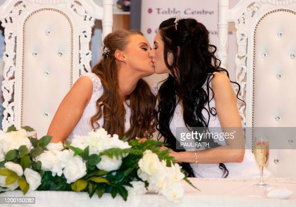 Robyn Peoples and Sharni Edwards kiss after becoming the first samesex couple to get married in Northern Ireland in Carrickfergus north of Belfast on...