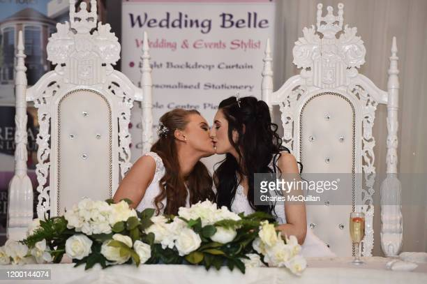 Robyn Peoples and Sharni Edwards kiss after they became Northern Ireland's first legally married same sex couple on February 11 2020 in Carrickfergus...
