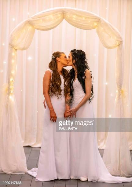 Robyn Peoples and Sharni Edwards kiss as they pose for photographs after becoming the first samesex couple to get married in Northern Ireland in...