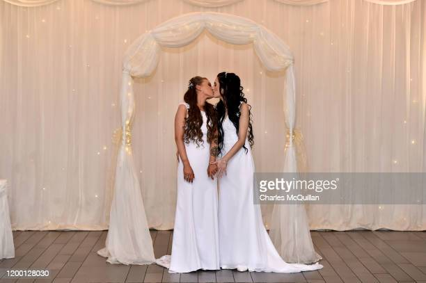 Robyn Peoples and Sharni Edwards kiss each other after they became Northern Ireland's first legally married same sex couple on February 11 2020 in...