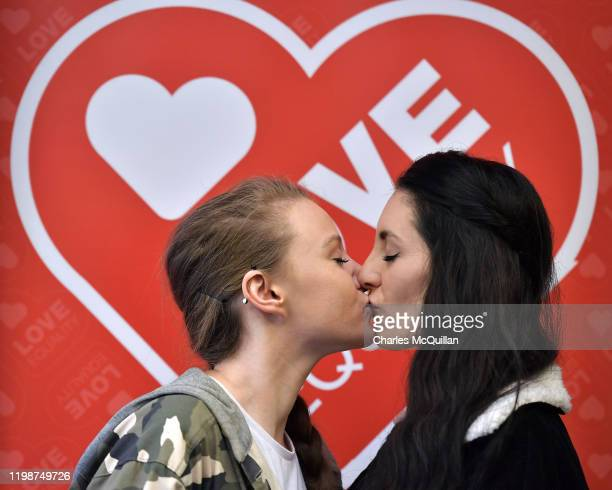 Robyn Peoples and Sharni Edwards Northern Ireland's first samesex couple to be legally married kiss during a prewedding press conference on February...