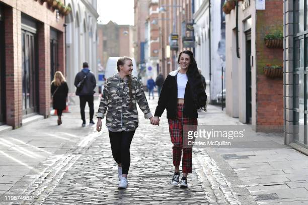 Robyn Peoples and Sharni Edwards Northern Ireland's first samesex couple to be legally married hold hands as they walk down the street following a...