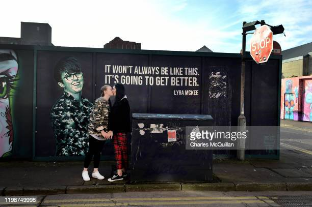 Robyn Peoples and Sharni Edwards Northern Ireland's first samesex couple to be legally married embrace and kiss in front of the Lyra McKee mural...