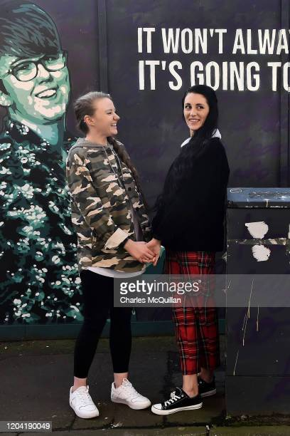 Robyn Peoples and Sharni Edwards Northern Ireland's first samesex couple to be legally married pose in front of the Lyra McKee mural during a photo...