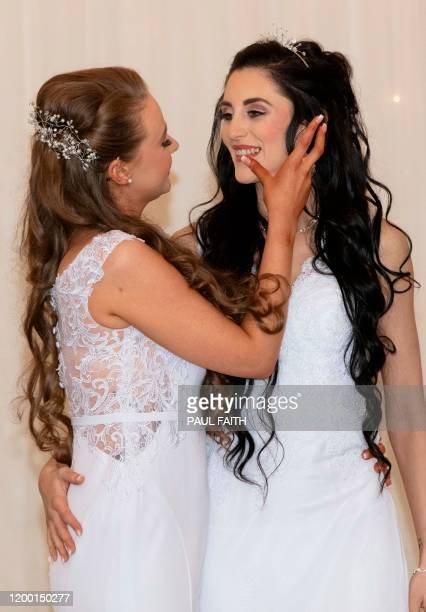 Robyn Peoples and Sharni Edwards pose for photographs after becoming the first samesex couple to get married in Northern Ireland in Carrickfergus...