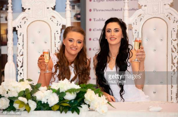 Robyn Peoples and Sharni Edwards pose for the media after becoming the first samesex couple to get married in Northern Ireland in Carrickfergus north...