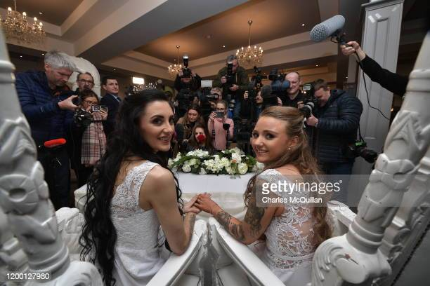 Robyn Peoples and Sharni Edwards pose for the media after they became Northern Ireland's first legally married same sex couple on February 11 2020 in...