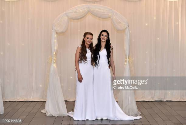 Robyn Peoples and Sharni Edwards pose for the media after they became Northern Irelands first legally married same sex couple on February 11 2020 in...